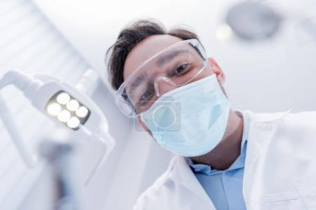 Dentist in protective mask
