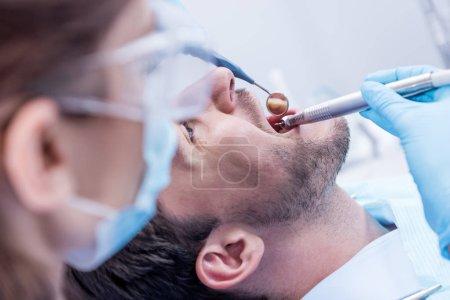 Dentist curing patients teeth