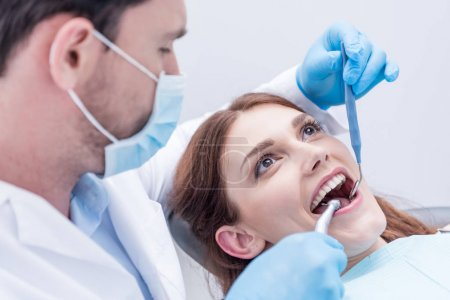 Dentist curing patients teeth