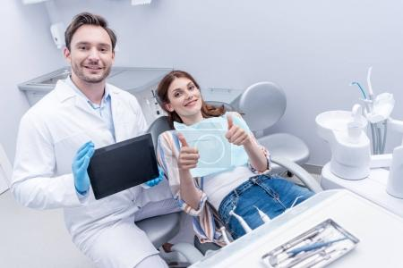 Patient and dentist with tablet
