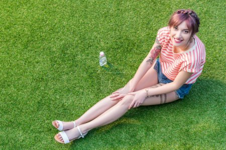 Young woman resting on grass