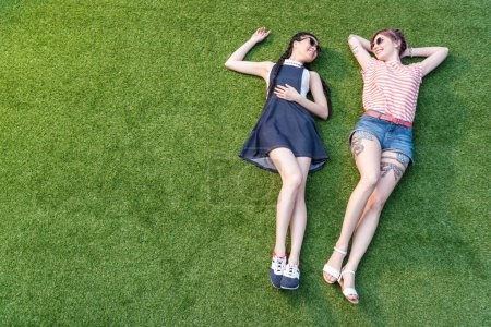 Multiethnic girls lying on grass