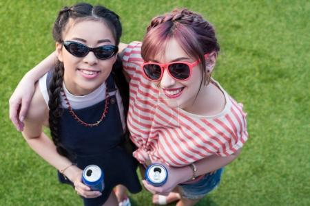 Multiethnic girls with soda cans