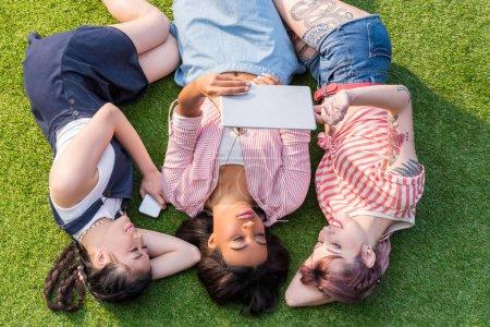 Multiethnic girls using digital tablet