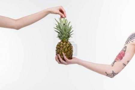 Female hands with pineapple