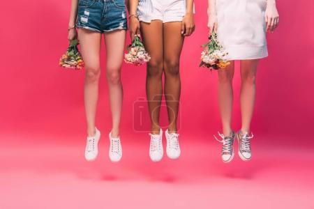 Multiethnic girls with flowers