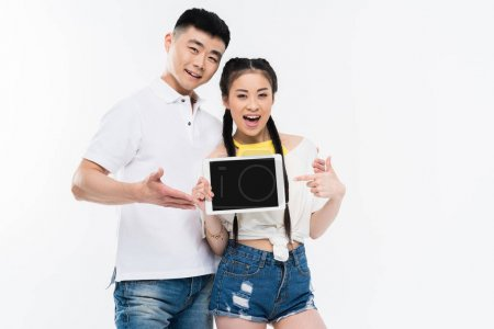 Asian couple with digital tablet