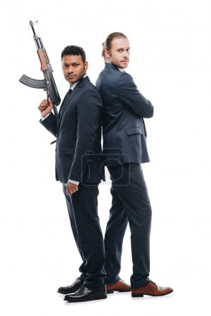Multiethnic bodyguards with rifle