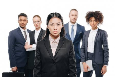 Asian businesswoman with colleagues