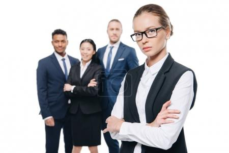 Confident businesswoman with colleagues