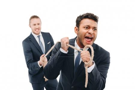 Businessman pulling rope