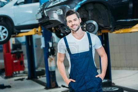 Smiling young automechanic