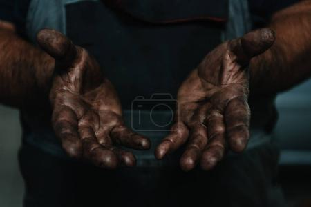 Male hands covered in oil