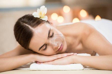 Woman relaxing in spa salon