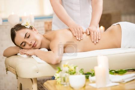 Woman relaxing and having massage