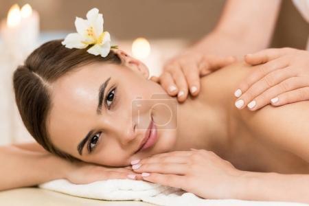 Attractive woman having massage