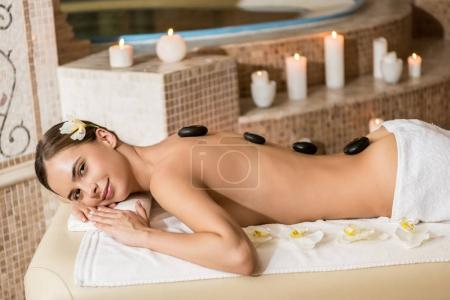 Woman having stone therapy