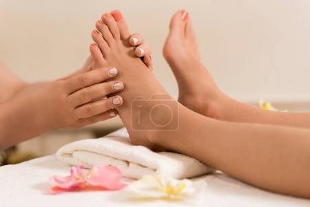 Woman having feet massage