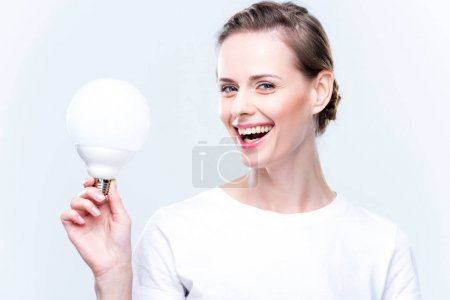Happy woman with light bulb