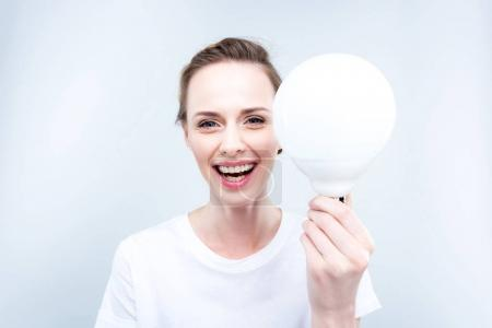 Lighting woman with light bulb