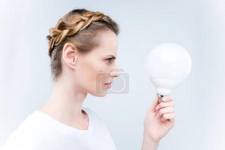 Focused woman with light bulb