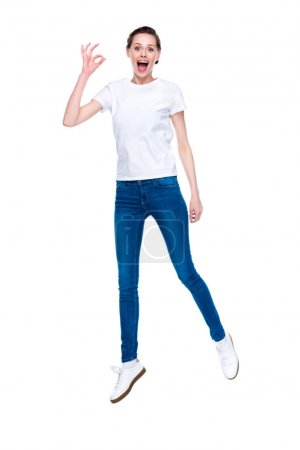Excited woman with ok sign