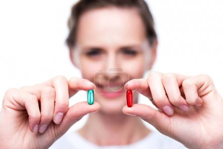 Woman with red and blue pills