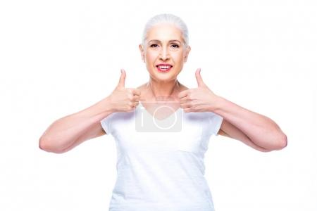 Senior woman with thumbs up