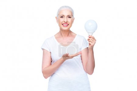 Senior woman with light bulb