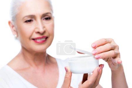 Senior woman with anti-wrinkle cream