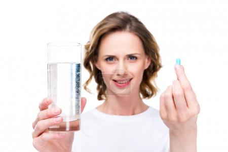 Glass of water and pill