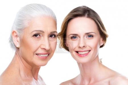 Smiling adult daughter and mother
