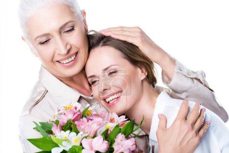 Senior mother hugging adult daughter