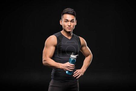 Asian sportsman with sports bottle
