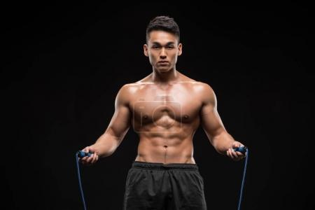 Muscular man with skipping rope