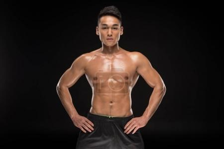 Shirtless muscular asian man