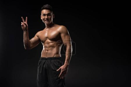 Sportsman showing victory sign