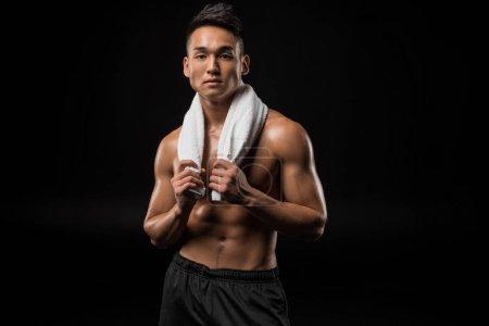 Muscular asian man with towel