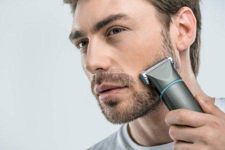 Man using electric razor