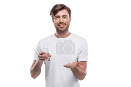 Man with pills and glass of water