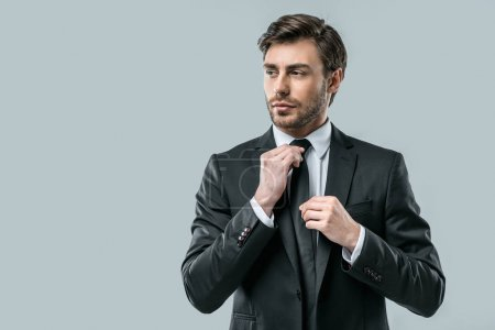 businessman in suit wearing tie