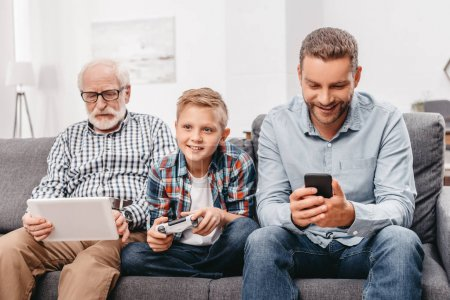 Family on couch with devices