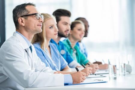 Doctors sitting at table