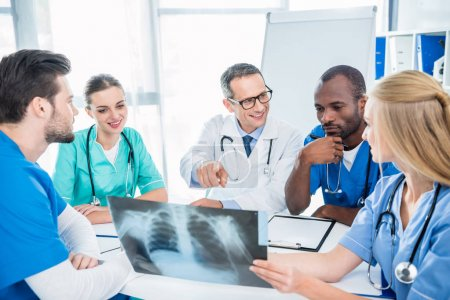 Team of doctors discussing x-ray scan