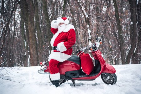 Santa Claus sitting on red scooter