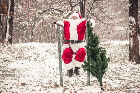 Santa Claus doing push ups in forest