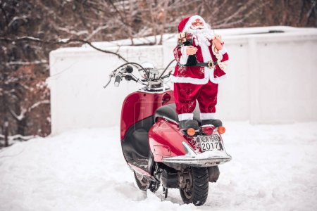 Santa Claus standing on back of scooter