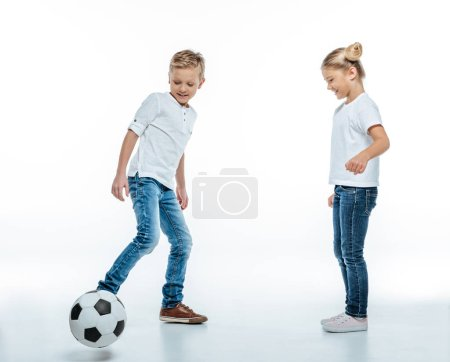 Smiling children playing with soccer ball