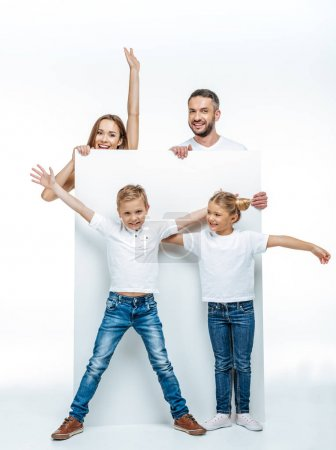 Cheerful family holding blank card