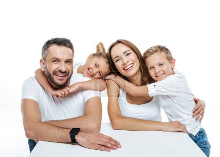 Photo for Close-up portrait of smiling family in white t-shirts hugging and looking at camera isolated on white - Royalty Free Image
